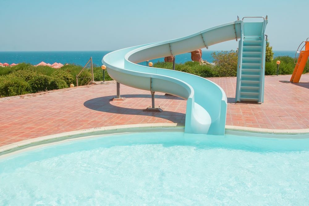 Swimming Pool With Slide For Children Photograph By Goce Risteski
